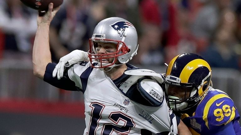 Tom Brady under pressure from Aaron Donald in the Patriots' low-scoring Super Bowl win over the Rams