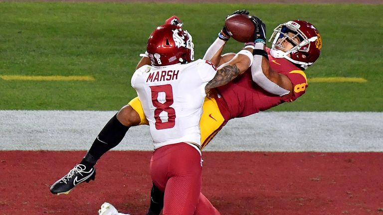 St Brown hauls in one of his four touchdowns against Washington State (Louis Lopez/CSM via AP Images)