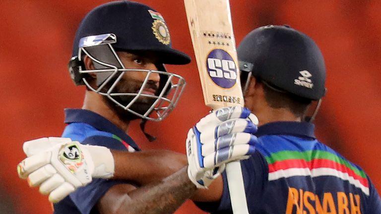 India's Suryakumar Yadav raises his bat and hugs team-mate Rishabh Pant after reaching his half-century