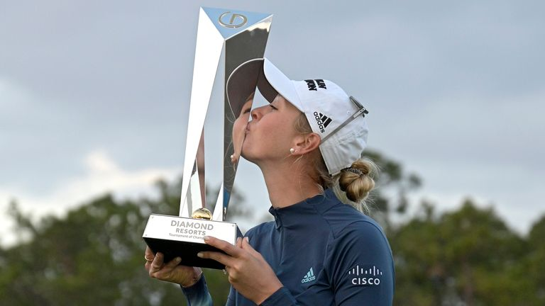 Jessica Korda kisses the trophy after winning the Tournament of Champions