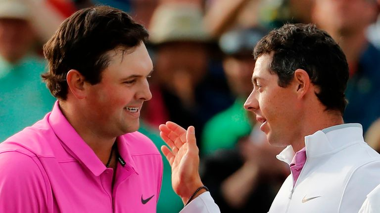 Patrick Reed is congratulated by McIlroy after winning The Masters in 2018