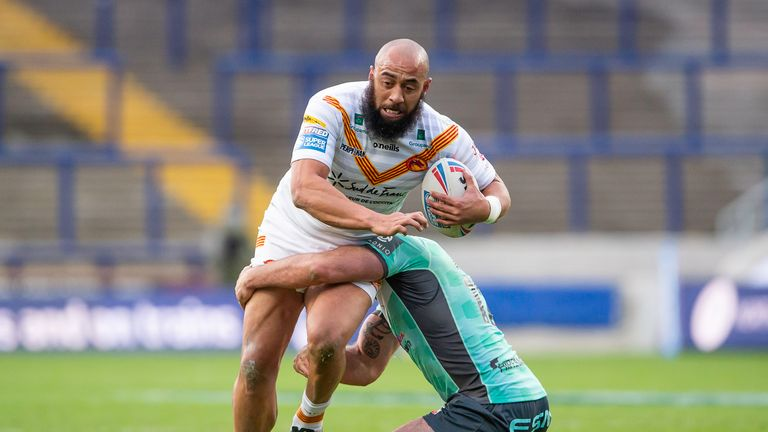 Catalans' Sam Kasiano takes on Hull KR's defence