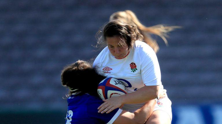England's Amy Cokayne runs with the ball