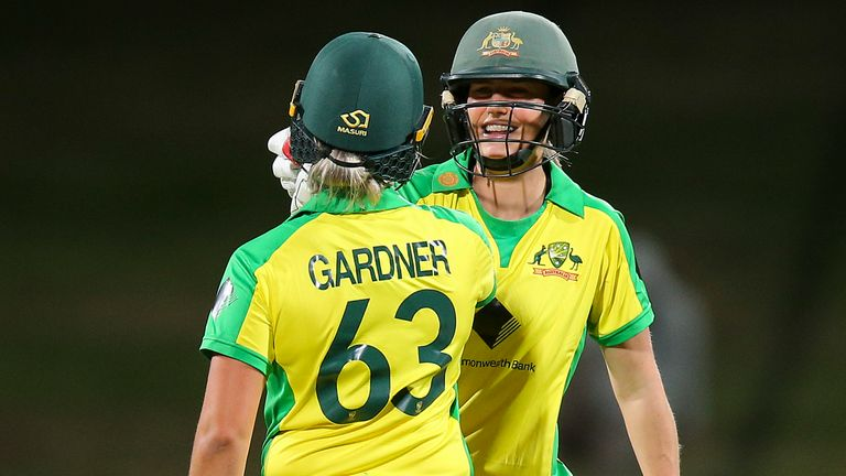 Ashleigh Gardner and Ellyse Perry celebrate Australia's world-record 22nd consecutive win in ODI cricket