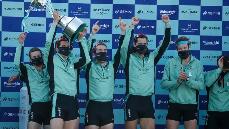 Cambridge men celebrate after defeating Oxford in the 2021 Boat Race