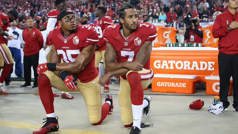 Eric Reid (35) and Colin Kaepernick (7) take a knee during the National Anthem prior to their 49ers' 2016 season opener against the Los Angeles Rams. (Daniel Gluskoter/AP Images for Panini)