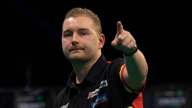 Dimitri Van den Bergh can return to the top of the Premier League Darts table on Monday - but he faces Jonny Clayton, another debutant not phased by the event
