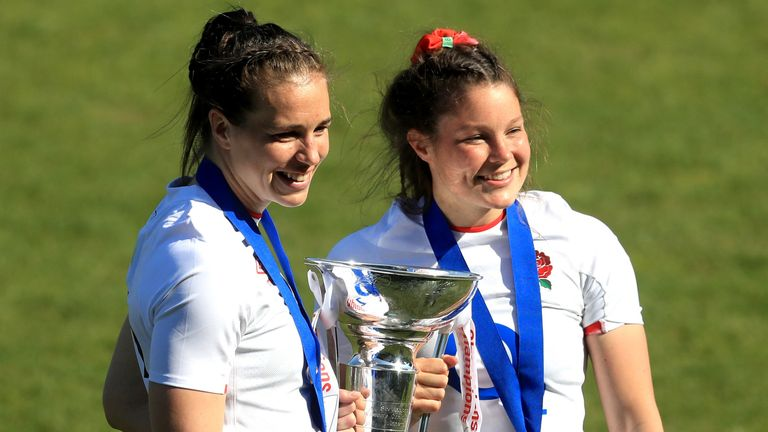 Emily Scarratt and Jess Breach celebrate with the trophy after England's win in the Six Nations final