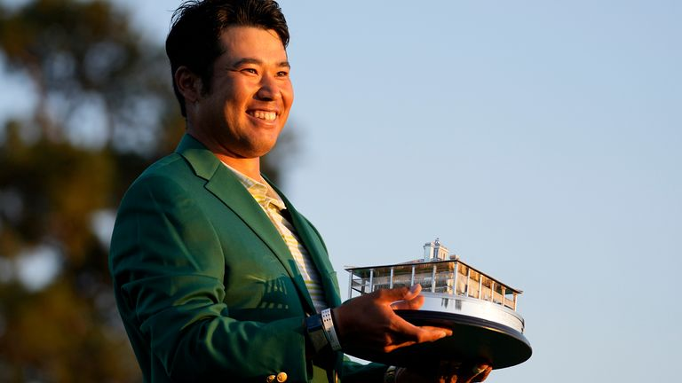 Matsuyama proudly sports the green jacket after his one-shot win