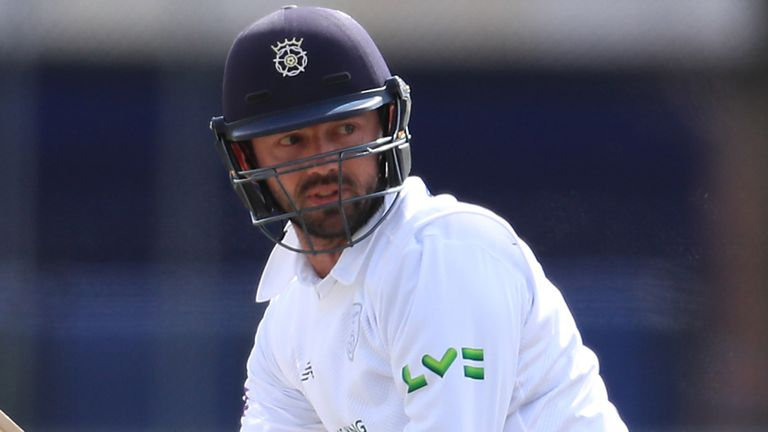 Ian Holland's half-century has helped Hampshire earn a first-innings lead over Gloucestershire