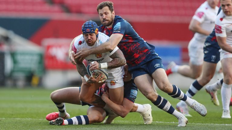Jack Nowell is tackled by Bristol Bears' Max Malins and Luke Morahan