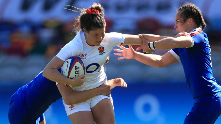 England's Jess Breach (centre) is tackled as she attempts to charge through
