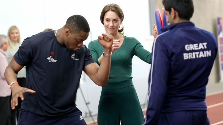 The Duchess of Cambridge is shown Taekwondo moves by Great Britain's Muhammad