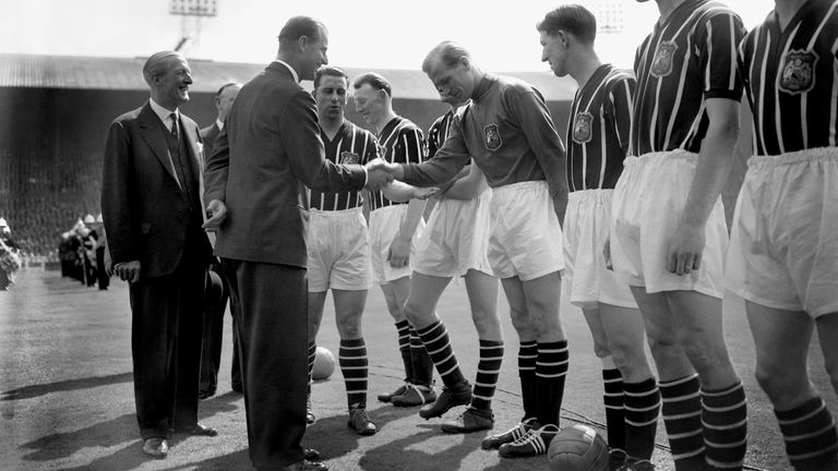 The Duke of Edinburgh shakes hands with Manchester City's Footballer of the Year Bert Trautmann, as he meets the teams before the FA Cup final against Birmingham at Wembley in 1956