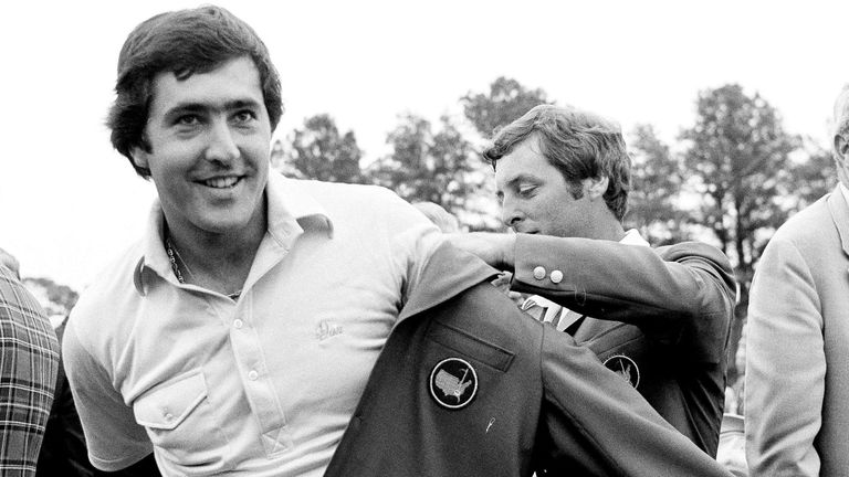 Ballesteros is helped with his Masters green jacket by the previous year's winner Fuzzy Zoeller after winning the 1980 Masters