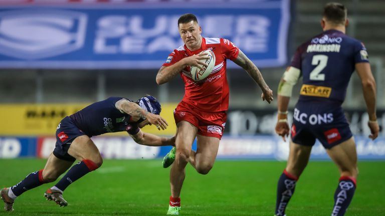 Hull KR's Shaun Kenny-Dowall is tackled by St Helens' Theo Fages