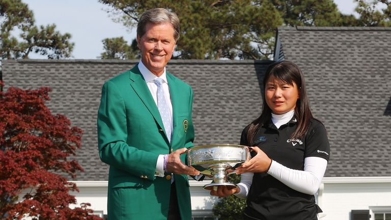 Masters chairman Fred Ridley presents Tsubasa Kajitani with the trophy after the final round of the Augusta National Women's Amateur