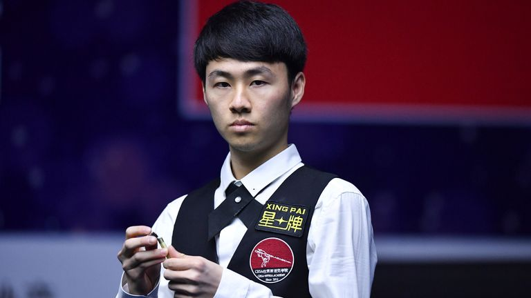 Xu Si of China put an end to Hendry's hopes of returning to the Crucible (Imaginechina via AP Images)