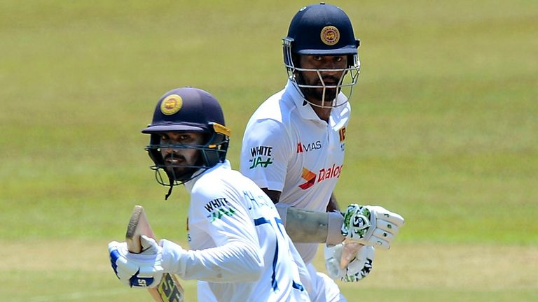 Dhananjaya de Silva (front) and Dimuth Karunaratne (back) put on a record 345 for Sri Lanka's fourth wicket