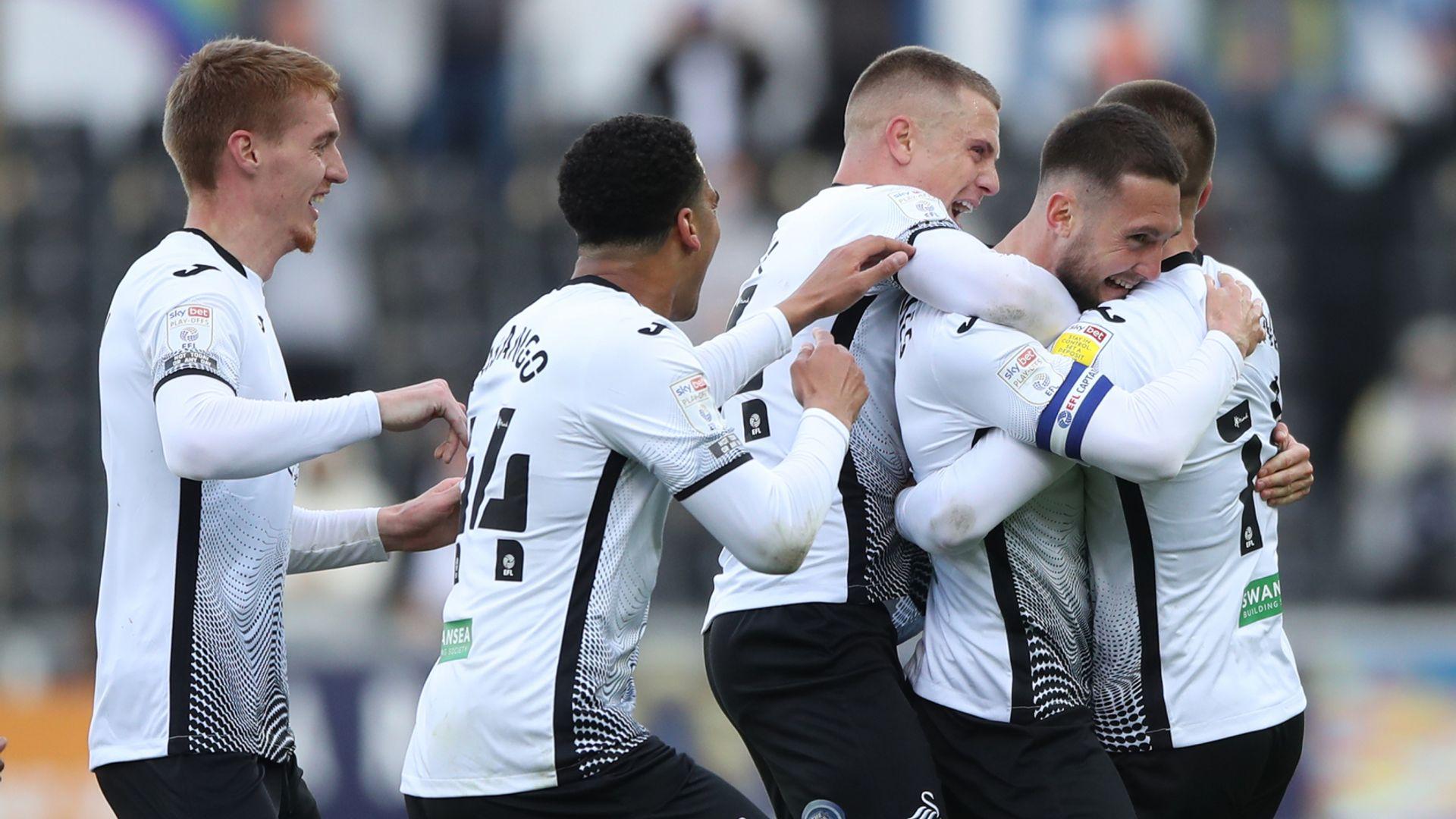 Swansea set up Wembley date with Brentford