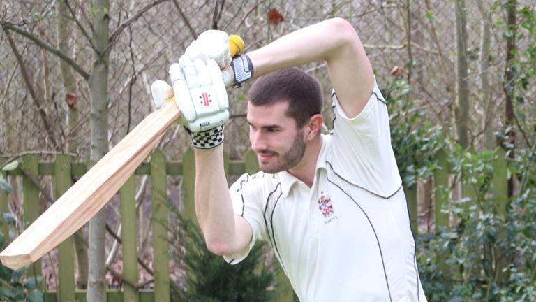 Ben Tinkler-Davies practices with a bamboo bat prototype