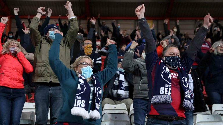 Bristol Bears fans react in the stands as they watch their team in action for the first time since March 2020