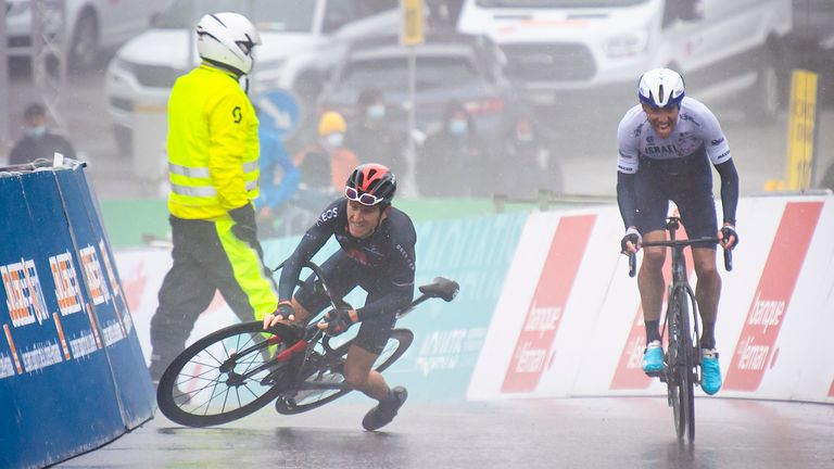Thomas falls as stage four winner Michael Woods crosses the finish line