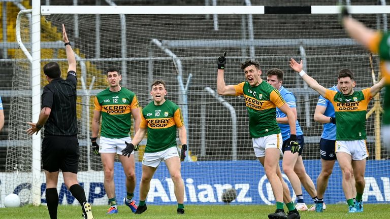 Kerry players remonstrate with referee Sean Hurson after he awarded the free