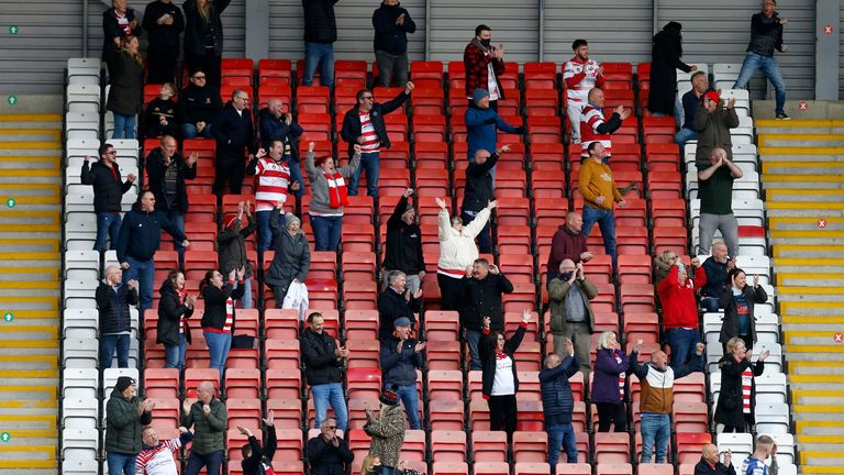 Leigh fans celebrate their team's second try