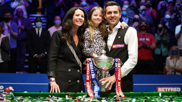 Selby celebrated his latest world title win with his wife and daughter