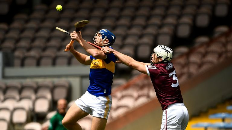 John McGrath of Tipperary in action against Daithí Burke of Galway