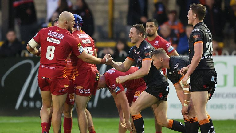 Castleford Tigers and  Catalans Dragons  players at the end of the game