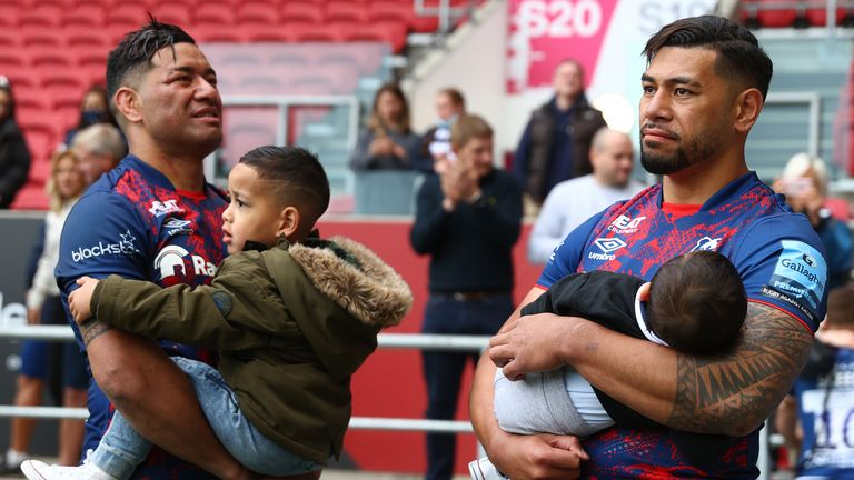 Charles Piutau (r) and Siale Piutau of Bristol Bears look dejected as they hold their sons