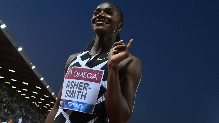 Dina Asher-Smith celebrates after winning the 200m at the Diamond League meeting in Florence