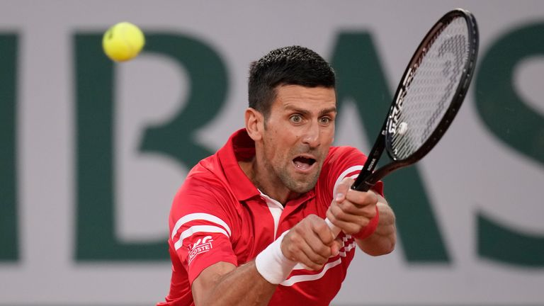 Top seed Djokovic produced a vintage display to triumph in the first ever men's night match at the French Open