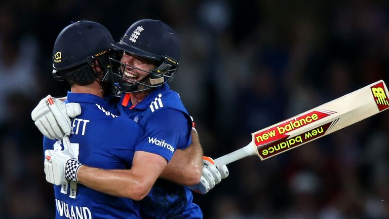Chris Woakes (R) embraces team-mate Liam Plunkett after his final-ball six earned England a tie in the first ODI against Sri Lanka at Trent Bridge in 2016