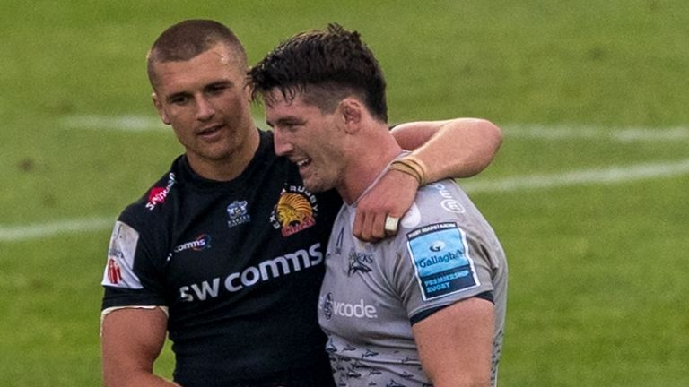Exeter Chiefs' Henry Slade and Sale Sharks' Tom Curry talk after the final whistle