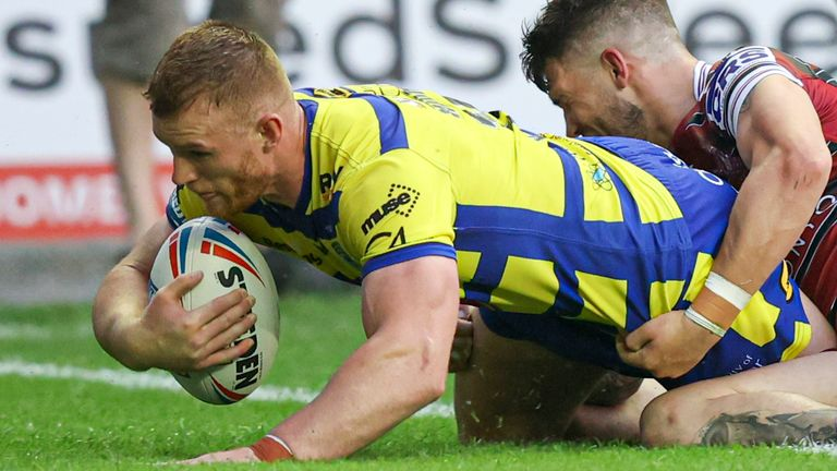 Jack Hughes goes over for a try