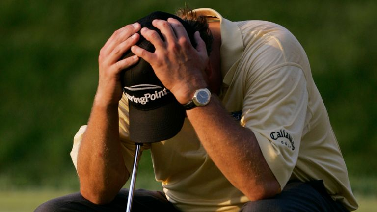 Mickelson hangs his head after a final-hole meltdown at Winged Foot in 2006