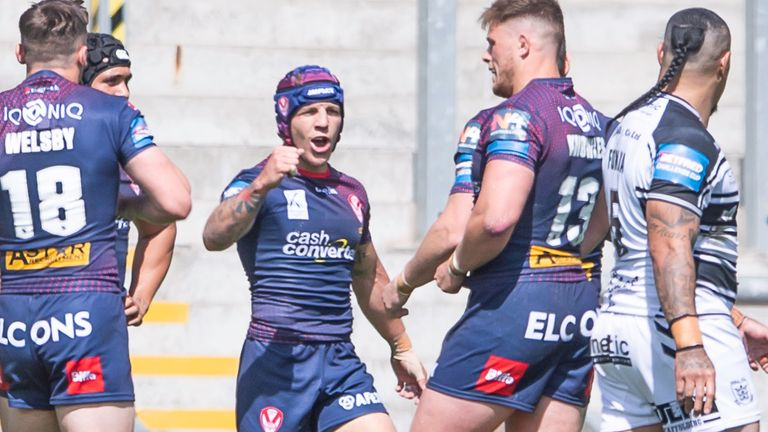 Theo Fages celebrates after scoring a try against Hull FC