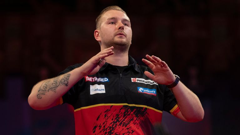 Van den Bergh stayed cool to punish Price's missed darts at double (Image: Lawrence Lustig/PDC)