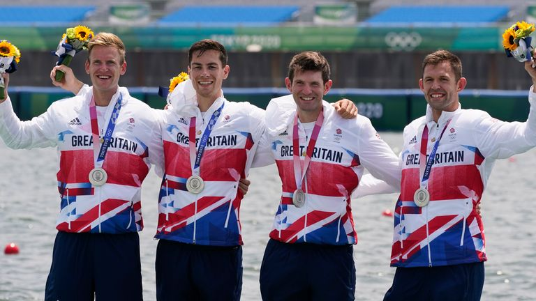 Harry Leask, Angus Groom, Tom Barras and Jack Beaumont celebrate winning their silver medal for Great Britain