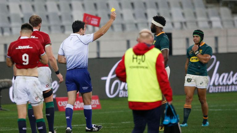 Referee Ben O'Keeffe shows Kolbe a yellow card in the opening period