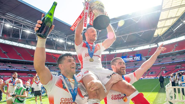 James Roby, Louie McCarthy-Scarsbrook and Kyle Amor celebrate with St Helens' fans