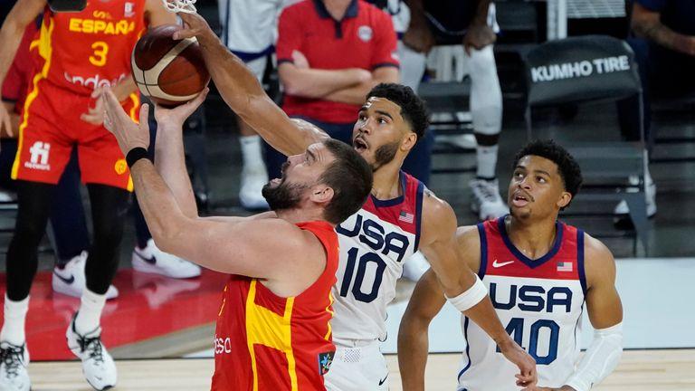 Spain's Marc Gasol takes it to the basket under pressure from Team USA's Jayson Tatum as Keldon Johnson looks on