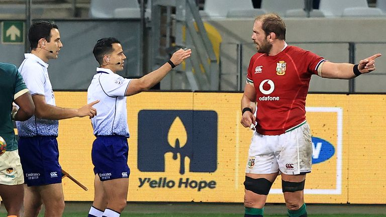 Referee Nic Berry speaks with Lions captain Alun Wyn Jones during the first Test