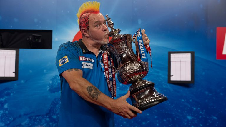 Peter Wright celebrates with the World Matchplay trophy (Lawrence Lustig/PDC)