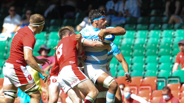Argentina's Rodrigo Bruni is tackled by Wales' Nick Tompkins