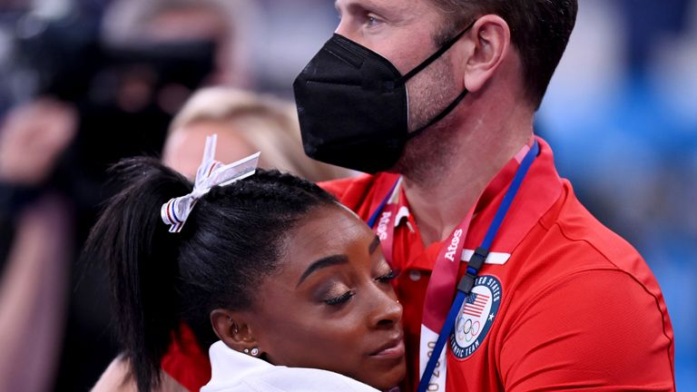 Biles was comforted by a USA coach during the women's team event