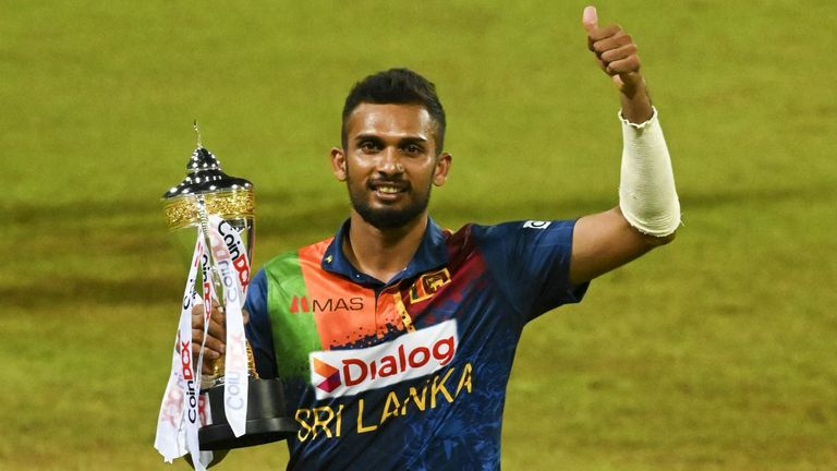 Dasun Shanaka celebrates with the trophy after his side secured a T20 series win over India